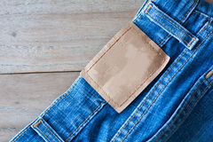 Jeans with back pocket and brown leather tag Stock Images