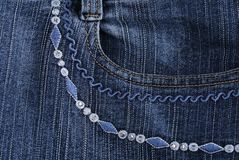 Jeans background. Ornament, embroidery, srtasses Stock Image