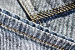 Jeans background. Close up of traditional, washed and jeans trousers Stock Photos