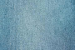 Jeans background of blue denim textile Stock Images