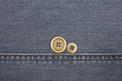 Jeans background with buttons. Royalty Free Stock Photos