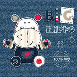Jeans background with cartoon hippo Stock Photos