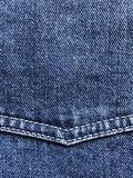Jeans background with corner yoke and double stitching. Denim background with copy space royalty free stock image