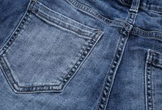 JEANS background, denim, texture with seams, old grunge vintage, Stitched , background of fashion design. Royalty Free Stock Images