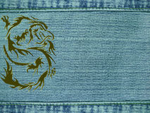 Jeans background with dragon Royalty Free Stock Photos