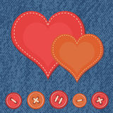 Jeans background with hearts Stock Images