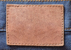 Jeans background with label. Jeans background with leather label Stock Images
