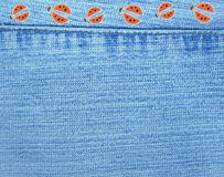Jeans background with ladybugs Royalty Free Stock Images