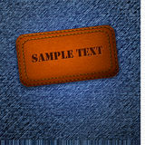 Jeans background with leather label. Vector Stock Photos