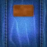 Jeans background with a leather label Stock Images