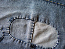 Jeans background with patches. Stock Photo