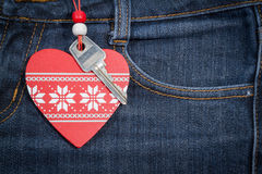 Jeans background with wooden heart and key..Valentine's day. Stock Photography