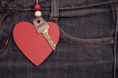 Jeans background with wooden heart and key..Valentine's day. Stock Photo