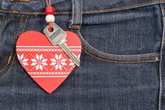 Jeans background with wooden heart and key..Valentine's day. Royalty Free Stock Photo