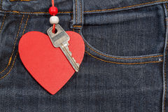 Jeans background with wooden heart and key..Valentine's day. Royalty Free Stock Images