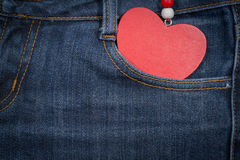 Jeans background with wooden heart.Valentine's day. Stock Image