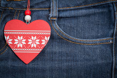 Jeans background with wooden heart.Valentine's day. Royalty Free Stock Images