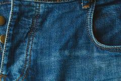 Jeans bakgrund, flåsandegrov bomullstvill med den knäppte upp flugan arkivbild