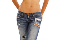 Jeans and bare top. Young woman with bare top wearing worn jeans Royalty Free Stock Photography