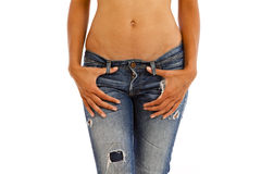 Jeans and bare top. Young woman with bare top wearing worn jeans Royalty Free Stock Images