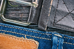 Jeans and belt background Stock Images