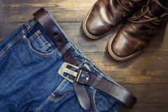 Jeans belt and shoed set on wood Stock Image