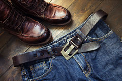 Jeans belt and shoed set on wood Royalty Free Stock Image