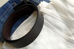 Jeans and belts. White Jeans, Blue Jeans and Belts royalty free stock image
