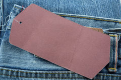 Jeans with blank paper price tag Stock Photography