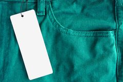 Jeans with paper price tag Royalty Free Stock Photography