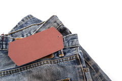 Jeans with blank paper price tag Royalty Free Stock Photo