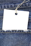Jeans with blank white tag Stock Images
