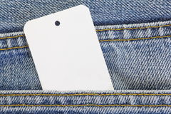 Jeans with blank white tag Royalty Free Stock Image