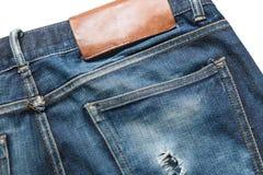 Jeans bleus de denim d'isolement sur le fond blanc Image stock