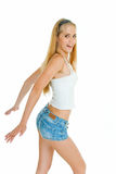Jeans blinkers. Smiling pretty girl in denim shorts; white background Stock Images