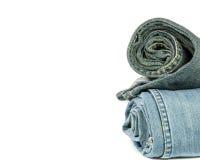 Jeans blu del denim del rotolo sistemati in pila Immagine Stock