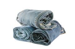 Jeans blu del denim del rotolo sistemati in pila Fotografia Stock