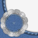 Jeans blue background with empty space. Circle with lace. Royalty Free Stock Images