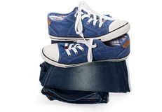Jeans and blue sneakers Stock Photo