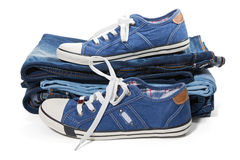 Jeans and blue sneakers Royalty Free Stock Photography