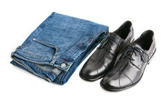 Jeans and boots. Blue jeans and black men boots white isolated stock image