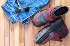 Jeans and Boots,Aviator sunglasses on top of wooden Stock Images