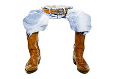 Jeans boots cowboy sit on Royalty Free Stock Photography