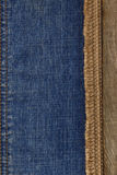 Jeans and of burlap hessian  background Stock Photos