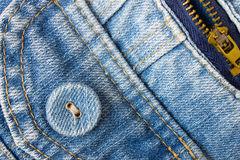 Jeans Button Bottom Left Corner With Part of Pocket and Zip Stock Photography