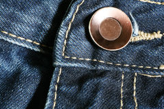 Jeans and button Royalty Free Stock Photos