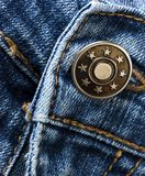 Jeans button Detail. A close up image of the button and stitching on a pair of jeans Stock Images