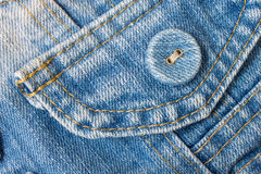 Jeans Button Top Right Corner With Part of Pocket on Pale Blue J Stock Image