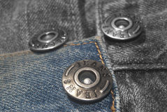 Jeans and buttons Royalty Free Stock Photos