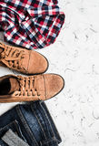 Jeans, checkered shirt and suede boots a light background. Women's clothing. Retro style stock photos